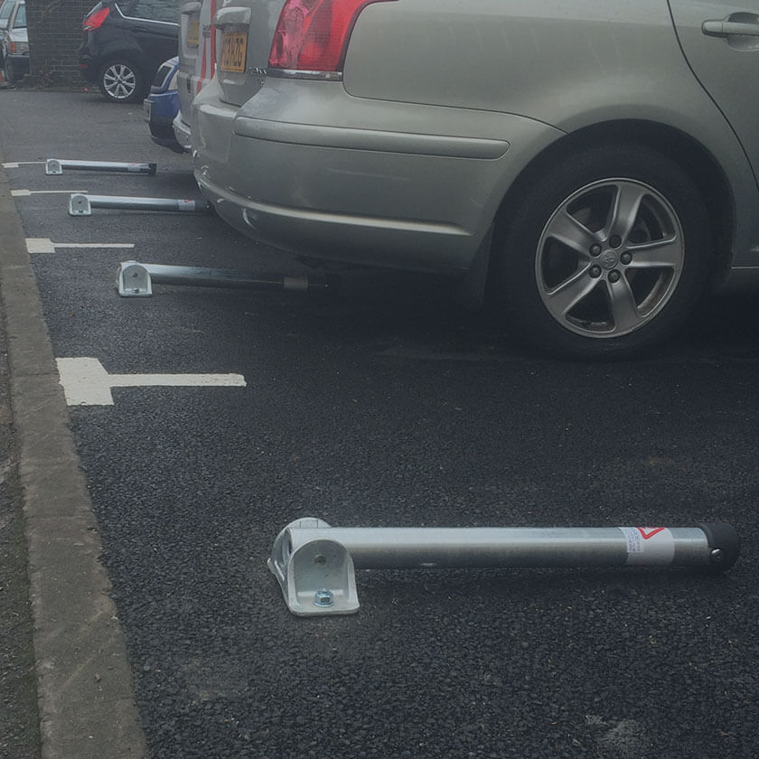 Fold down parking posts installed in a private car park