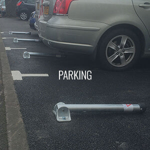 Fold down parking posts on a private car park