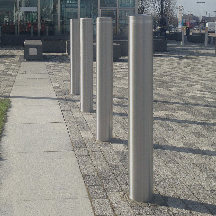 Stainless steel static bollards installed on a retail park