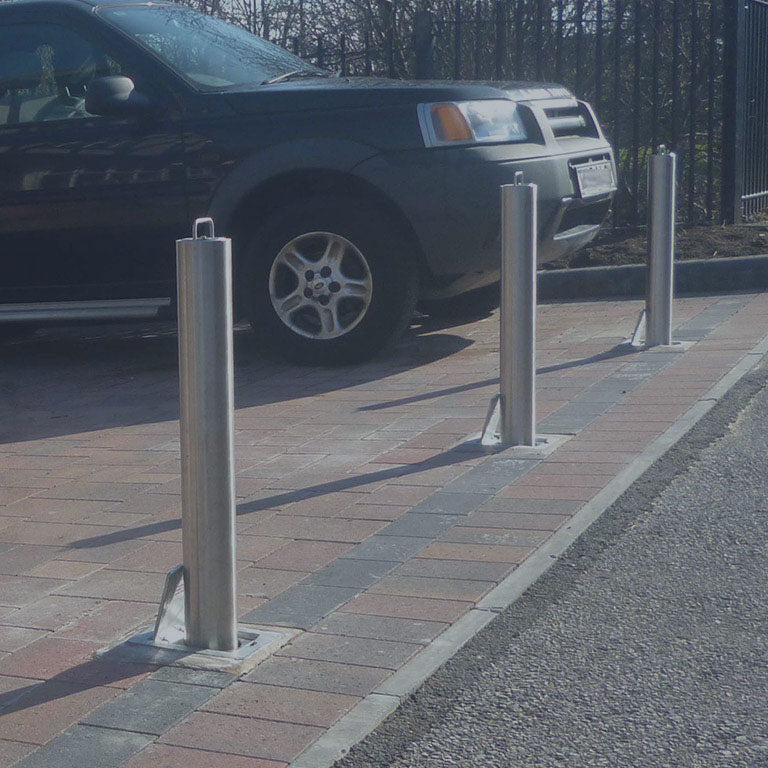 High-security stainless steel telescopic security bollards installed on a driveway