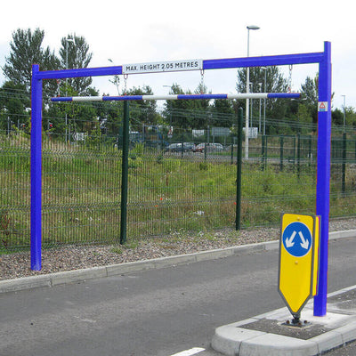 Fixed height restriction barrier in a Blue powder coated finish.