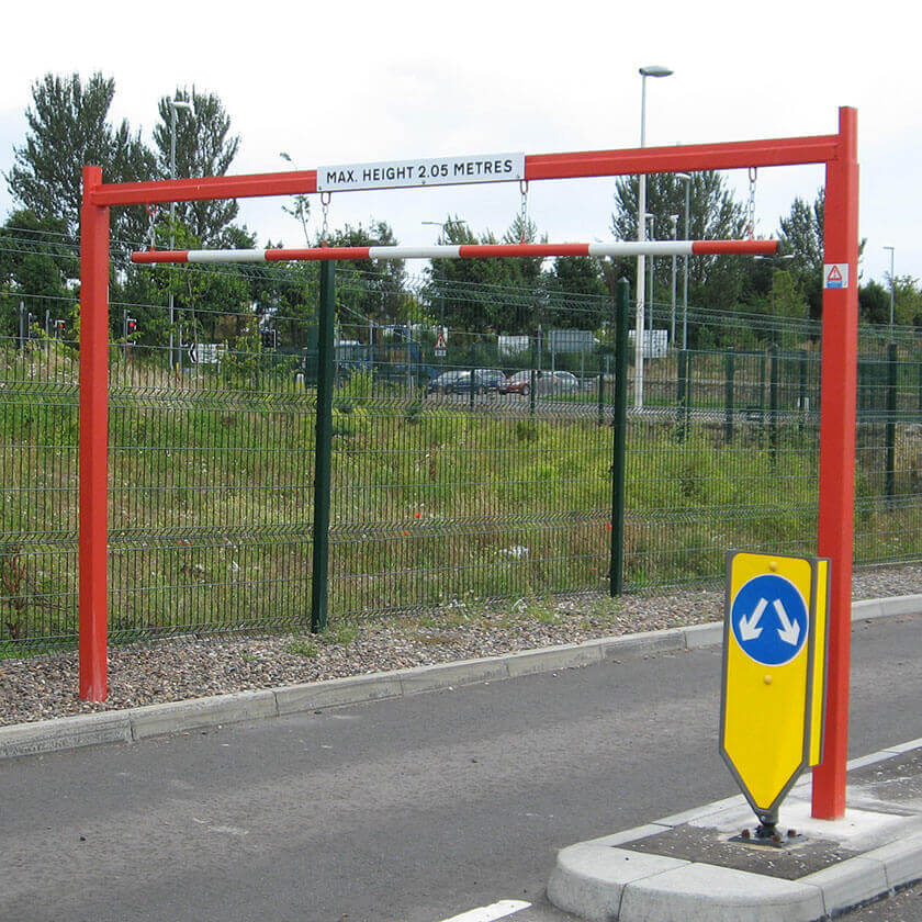 Fixed height restriction barrier in a Red powder coated finish.
