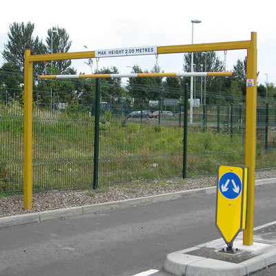 Fixed height restriction barrier in a Yellow powder coated finish.