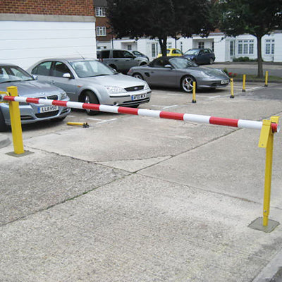 Manual arm barrier in a Yellow powder coated finish.
