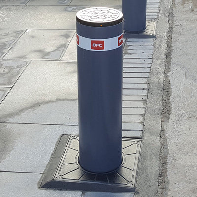 BFT - Easy 700 automatic rising bollard in graphite grey.