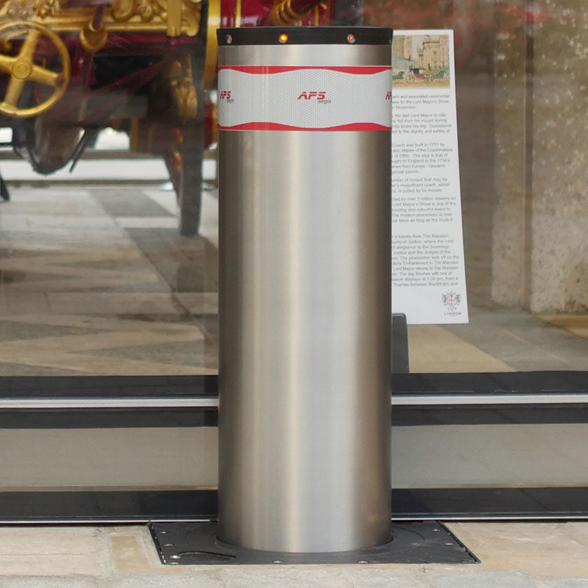 X-Pass B K4 Anti terrorist automatic rising bollard in stainless steel.