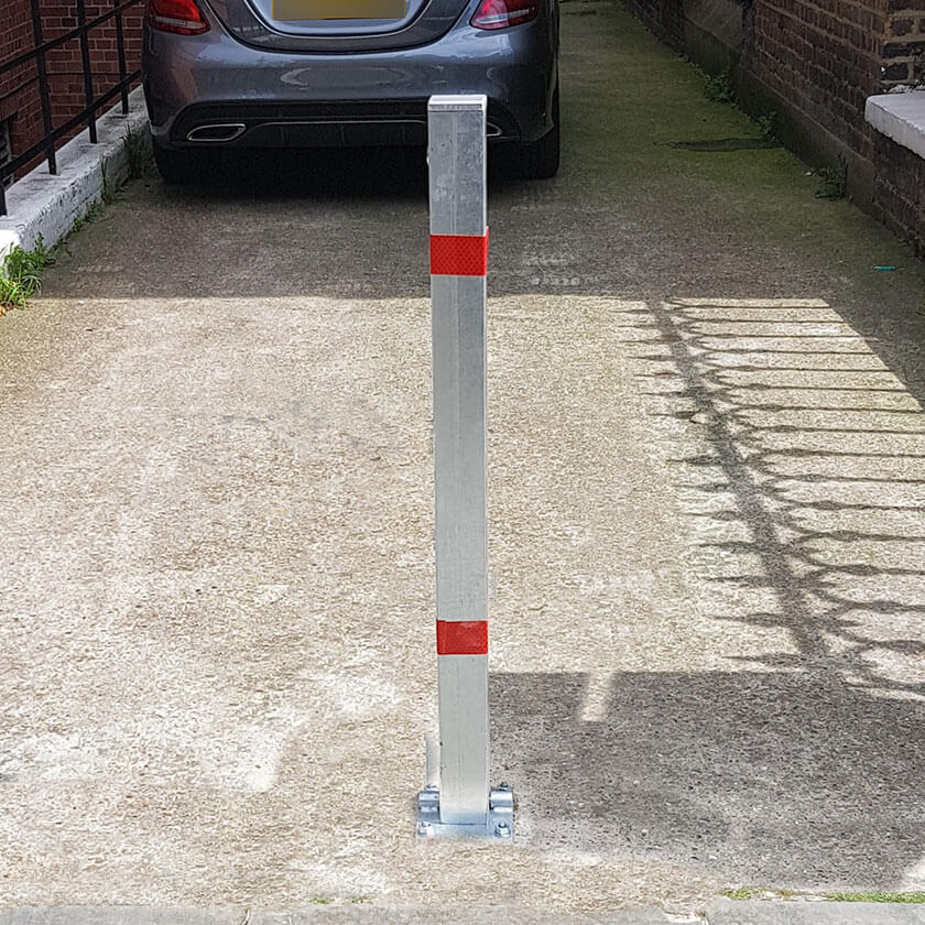 Controller-A fold down parking post in a galvanised finish.
