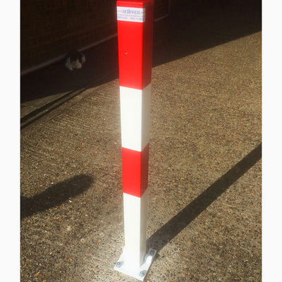 Controller-A fold down parking post in a White powder coated finish..