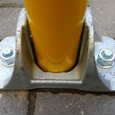 Hinged fold down parking post ground fixing plate