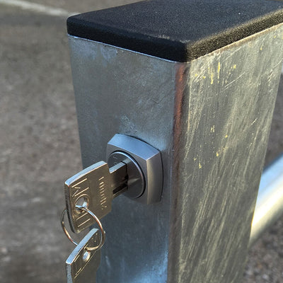 I-Frame parking barrier key and lock location.