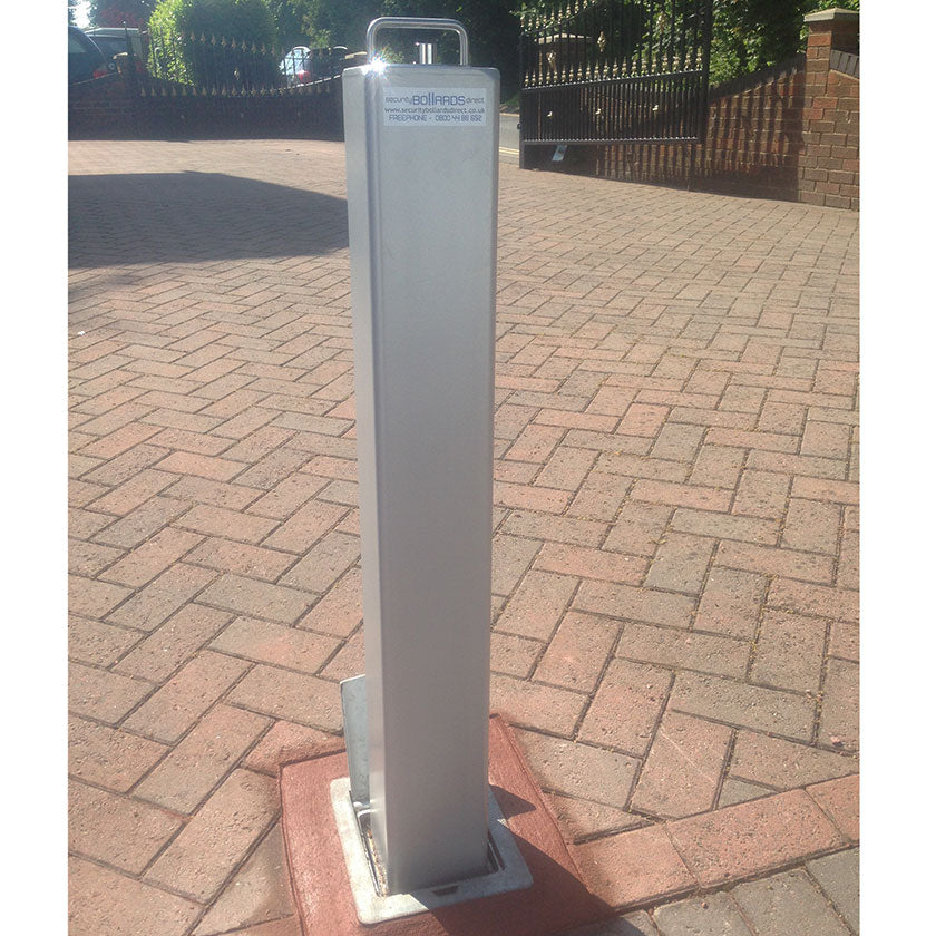 Lift assisted SQ20 telescopic bollard in Silver on a block paved driveway