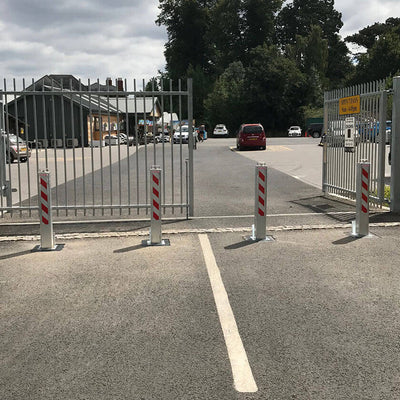 Lift assisted SQ20 telescopic bollards protecting gates