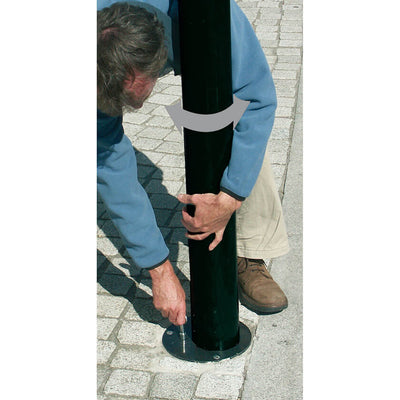 Unlocking the bollard from the ground socket.