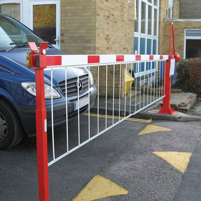 Manual arm barrier in a Red powder coated finish.