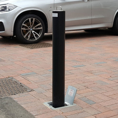 R14 Lift assist telescopic bollard in Black on a private car park