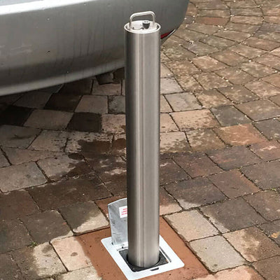 RD4S Stainless steel telescopic bollard on a block paved driveway