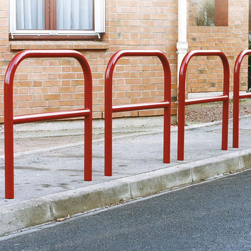 60mm static steel hoop barriers with a centre rail in Red.