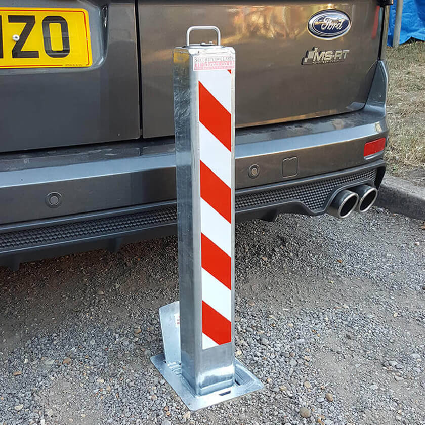 SQ8 anti ram raid telescopic security bollard protecting a Ford Transit Connect MS-RT