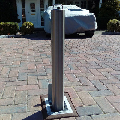 SS14 Stainless steel heavy duty telescopic bollard on a block paved driveway