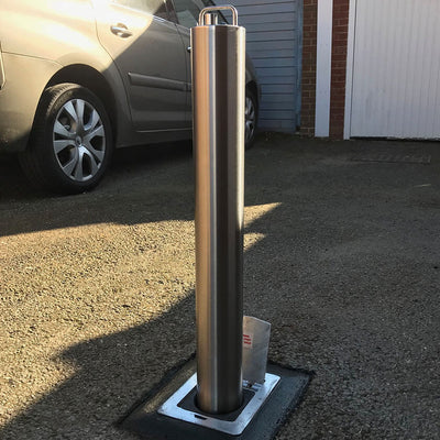 LA/S14 Lift assist stainless steel telescopic bollard on a gravel driveway