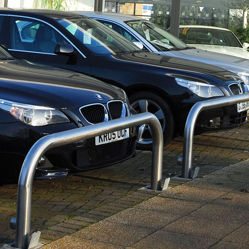 76mm tube stainless steel removable hoop barriers on a vehicle forecourt.