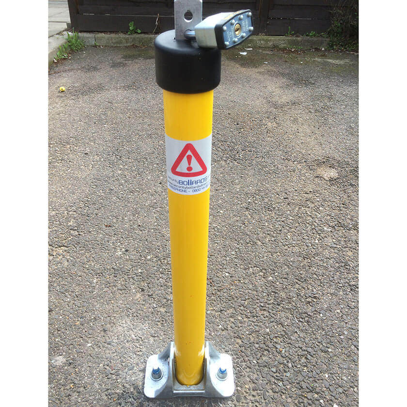 Top Lock fold down parking post in a Yellow powder coated finish