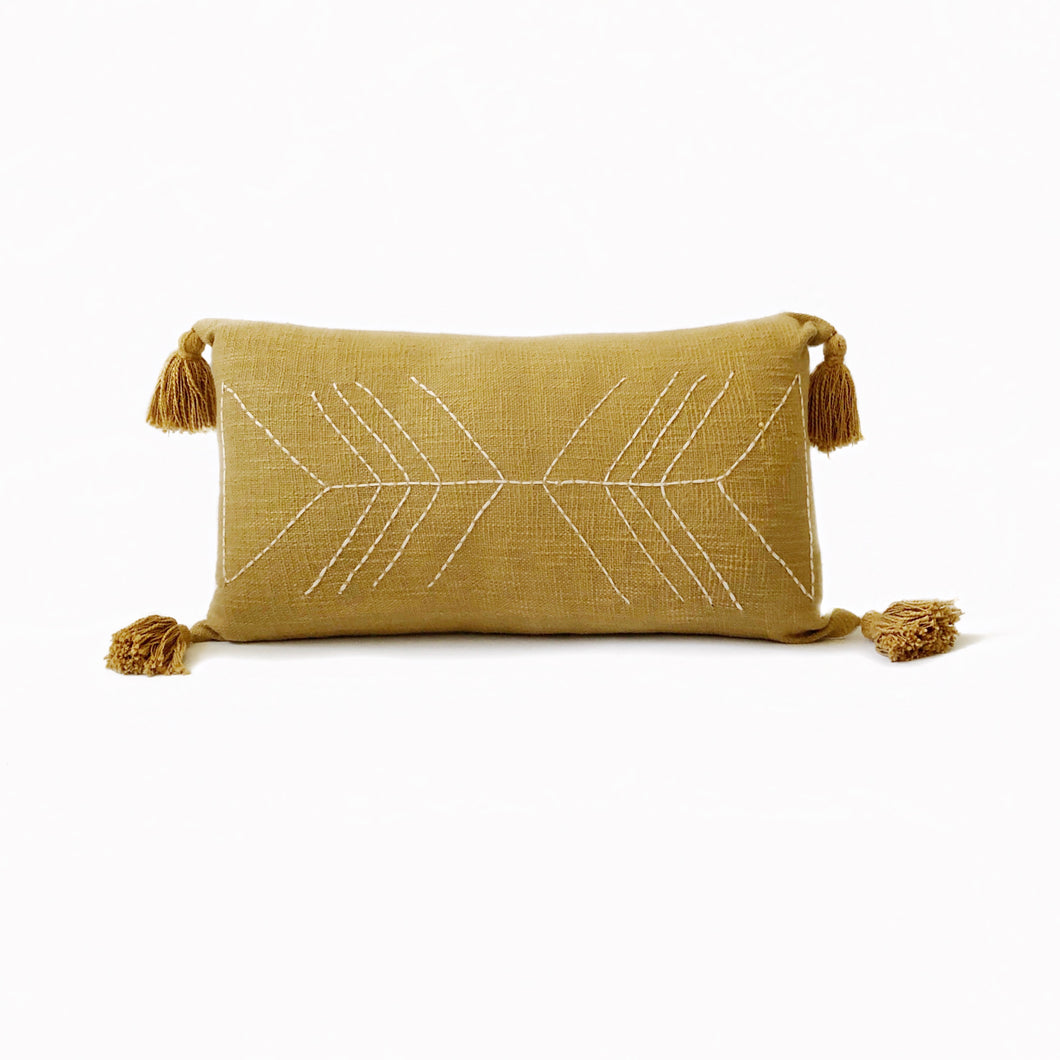 terracota lumbar pillow, terra cotta bohemian pillow, long boho pillow, mustard pillow, textured boho pillow, boho woven pillow, bohemian pillows, burnt orange bohemian pillow, vintage long pillow, lumbar mustad pillow, mustard lumbar pillow, pompom pillow, yellow pillow, pompom boho pillow, nazca pillow, moroccan pillows, hand stitched pillow, stitch by grace, urban outfitters home, anthropology pillows, beach essentials, coastal bohemian homes, coastal boho studio, earthy tones, pantone 2020