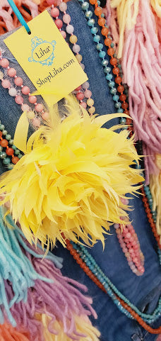 Liha's Signature Feather Pin/Clip adorned with coordinating Necklaces on the Liha Mobile Boutique