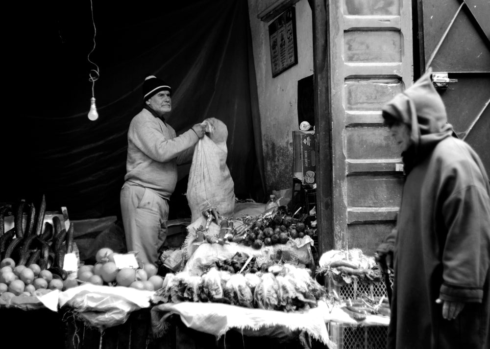 A man works to set up a shop in the Medina of Fez.