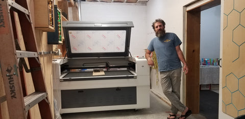 Scott Moore with the laser cutter