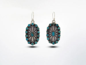 Western Inspired Oval Turquoise Earrings With Sunburst Design