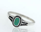 Oval Turquoise Ring With A Rope Border And Split Shank