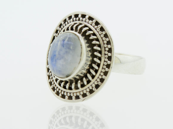 Oval Moonstone Ring With Braided Disc Design