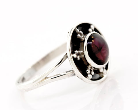 Garnet Ring With Unique Oxidized Silver Design