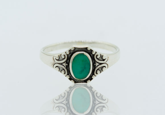 Oval Stone Ring with Elegant Swirl Filigree Design