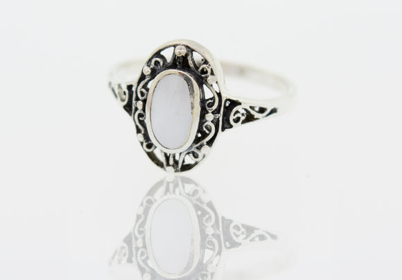 Oval Mother of Pearl Ring with Swirl Filigree Border