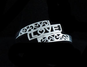 """Love"" Ring Framed with Filagree"