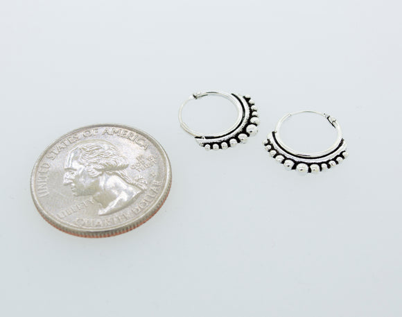 Small Silver Hoop Earrings with Freestyle Ball Design