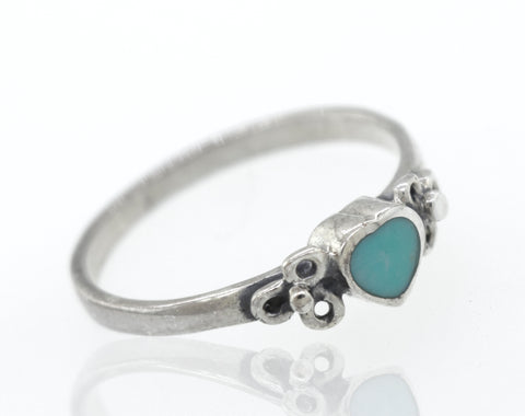 Turquoise Heart Ring With Flower Design On Either Side