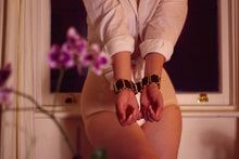 Load image into Gallery viewer, Bruise Sigrid silk gold plated brass hardware wrist cuffs on model