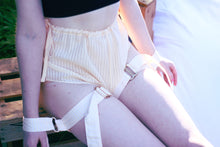 Load image into Gallery viewer, Miette thigh to wrist harness cuff on model sitting