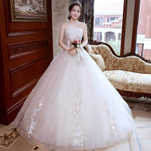 Load image into Gallery viewer, Vestido de Noiva Appliques Lace Flowers Princess Light champagne Wedding Dresses 2018 Strapless Train Ball Gown Bridal Dress