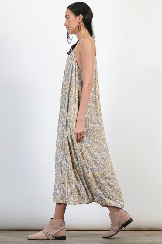 FLOWY ABSTRACT  PRINT SWING MAXI DRESS HALTER NECK AND SIDE POCKETS