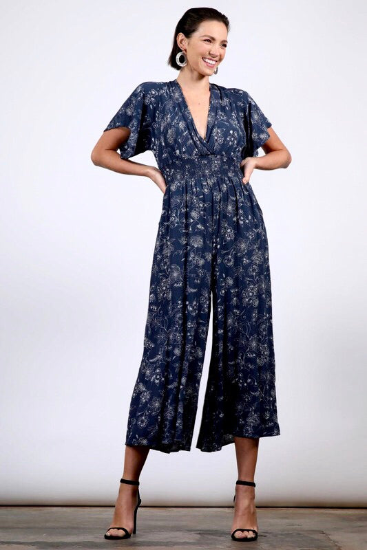 FLORAL PRINTED CRINKLE SURPLICE JUMPSUIT WITH BACK TIE
