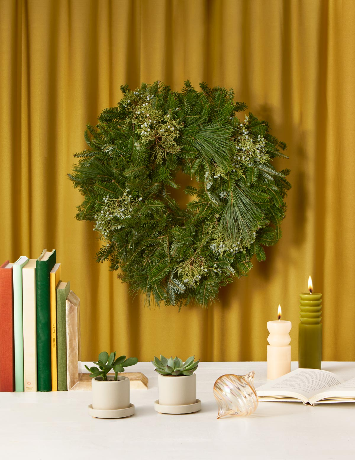 Gold drape wreath books