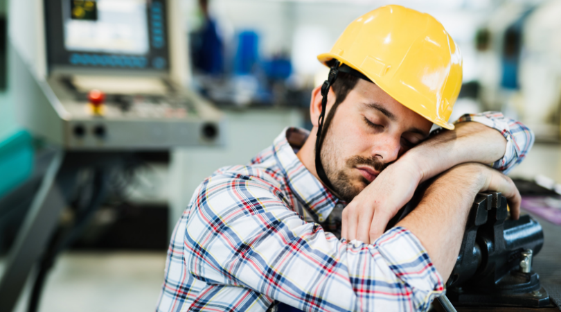 man sleeping at workplace