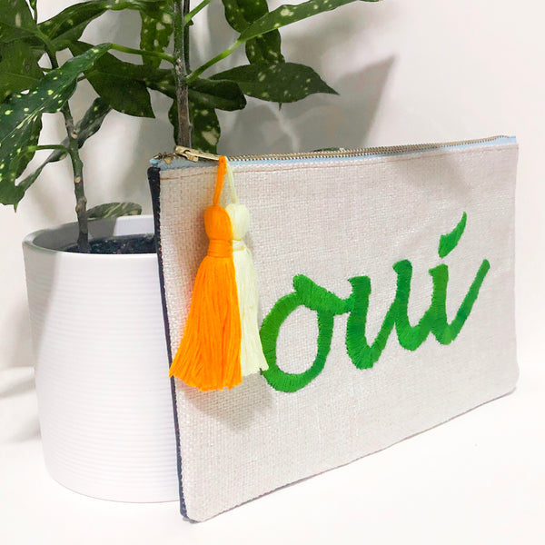 """Oui"" Embroidered Fabric and Leather Clutch"