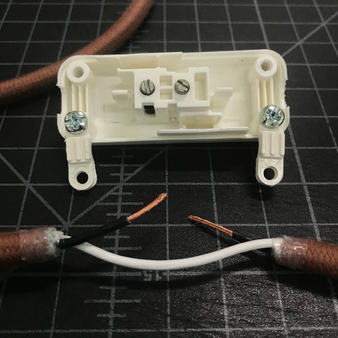 open vintage slim switch and pulley cord with hot wire stripped