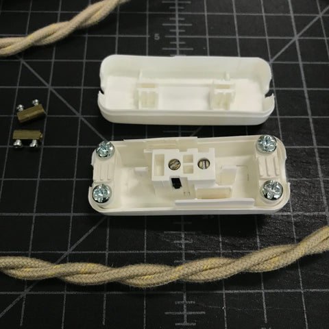 open vintage slim switch with brass bits removed and twisted pair wire