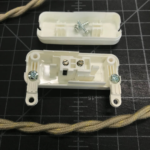 open vintage slim switch prepared for wiring with twisted pair wire